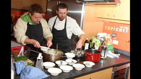 """Blais, left, and fellow """"Top Chef"""" contestant Andrew D'Ambrosi demonstrate at a """"Top Chef"""" interactive cooking show in New York in 2008."""