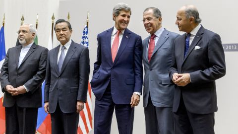 """(From L) Iranian Foreign Minister Mohammad Javad Zarif, Chinese Foreign Minister Wang Yi, US Secretary of State John Kerry, Russian Foreign Minister Sergei Lavrov and French Foreign Minister Laurent Fabius react during a statement on early November 24, 2013 in Geneva. World powers on November 24 agreed a landmark deal with Iran halting parts of its nuclear programme in what US President Barack Obama called """"an important first step"""". According to details of the accord agreed in Geneva provided by the White House, Iran has committed to halt uranium enrichment above purities of five percent.  AFP PHOTO / FABRICE COFFRINI        (Photo credit should read FABRICE COFFRINI/AFP/Getty Images)"""