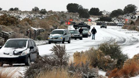 Cars slide on Paseo del Norte in Albuquerque on November 24.