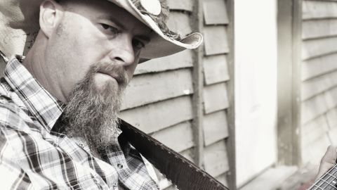 """Wayne Mills had been working on his seventh album, """"Long Hard Road,"""" and touring small Southern venues."""