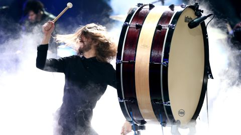 Wayne Sermon of Imagine Dragons bangs a drum during the band's performance.