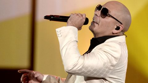 """Rapper Pitbull performs his new single, """"Timber,"""" with Ke$ha. He hosted the award show."""