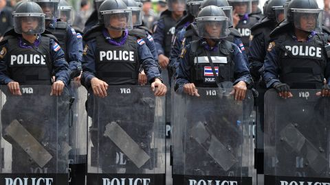 Thai riot police stand guard in Bangkok on Monday in an escalation of mass street rallies aiming to topple Prime Minister Yingluck Shinawatra's embattled government.