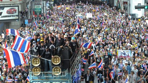 Demonstrators wave national flags during a rally in Bangkok on November 25, 2013.