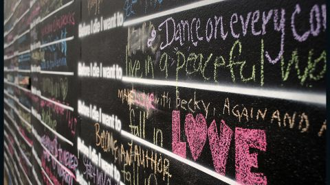 Giving and receiving love are recurring themes on the walls.
