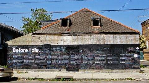 """Candy Chang created the first """"Before I Die"""" wall in 2011 on the side of an abandoned building in New Orleans. It disappeared a few months later when a developer bought the structure. Since then, more than 400 walls have sprung up in 60 countries, from Afghanistan to Chile. Check out some of the hopes and dreams being shared on walls around the globe:"""