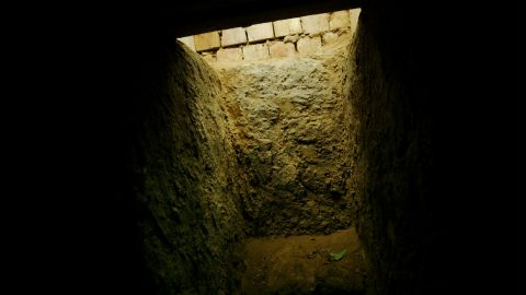 """The entrance to the """"spider hole"""" where Hussein was hiding."""