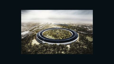 """The design for Apple's new headquarters looks more suited to the set of """"Star Wars' than Cupertino, California. The round structure has been compared to a space ship and the tree-filled central green space is the size of a small forest. Let's hope GPS systems are included in employee benefits."""