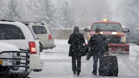 Holiday travelers make their way to their car on November 26 after arriving at Pittsburgh International Airport.