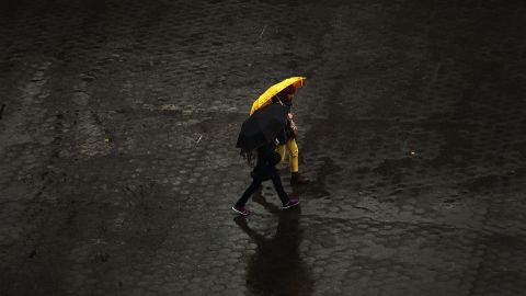 People walk in the rain through Union Square in Manhattan on November 26. New York was bracing for severe weather as the storm made its way east.