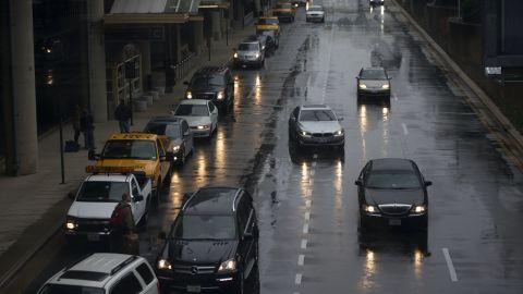 Vehicles pick up passengers in heavy rain at Reagan National Airport on November 26.