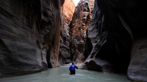 Zion National Park in Utah remained in seventh place on the park service's list of most popular national parks for the second year in a row. Here, a hiker wades up the Virgin River in the Zion Narrows.
