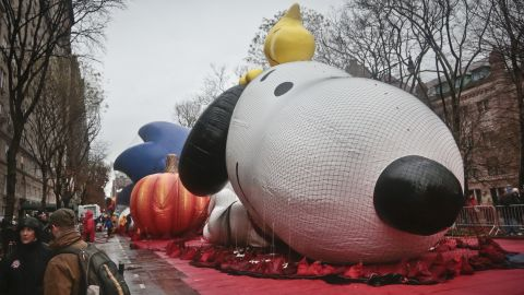 The Snoopy balloon for the Macy's Parade is partially inflated on Wednesday, November 27, in New York.  High winds threatened to keep the balloons on the ground during Thursday's Macy's Thanksgiving parade. A colossal storm system that began in California complicated Thanksgiving travel plans all the way to the Atlantic, causing many transportation delays.