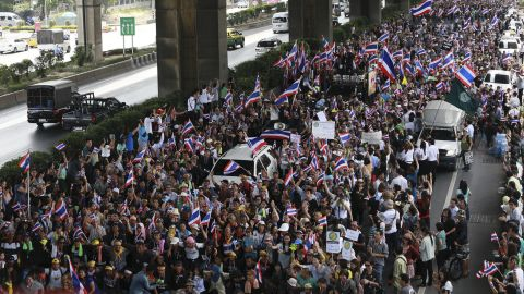 """Flag-waving protesters vowing to topple the Thai prime minister took to the streets of Bangkok for a fourth day Wednesday, declaring they would take over """"every ministry"""" of the government."""