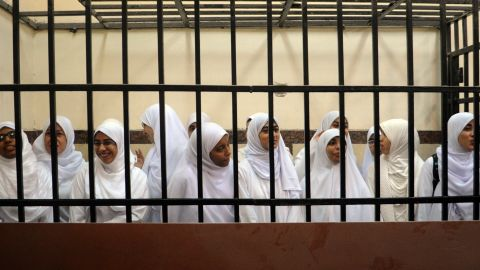 """Female members of the Muslim Brotherhood are seen during their trial in the Egyptian city of Alexandria on November 27, 2013. A court in the Mediterranean city sentenced 14 women who it said were from the Brotherhood after convicting them of belonging to a """"terrorist organisation, """" judicial sources said. AFP PHOTO/STR-/AFP/Getty Images"""