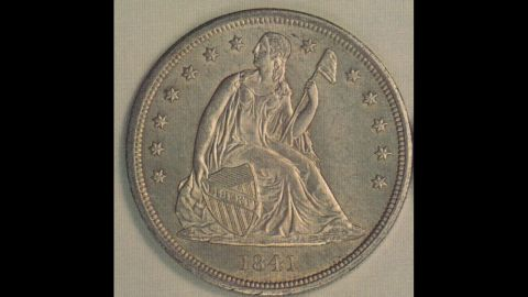 """The """"Seated Liberty"""" silver dollar was first produced in 1836 and ceased being made five years after the Statue of Liberty was installed in New York Harbor in 1891, according to the U.S. Mint."""