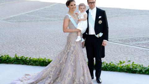 Crown Princess Victoria, Princess Estelle and Prince Daniel pose at a 2013 wedding.