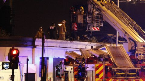 The helicopter, carrying two police officers and a civilian pilot, crashed on the roof of the pub at 10:25 p.m., according to Scottish police.
