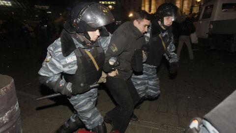 Ukrainian riot police detain a protester on November 30.