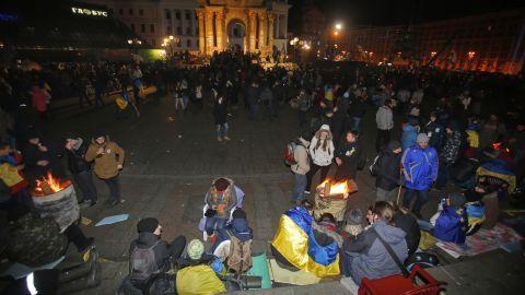 Protesters gather over bonfires November 30.