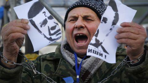 A demonstrator holds a torn portrait of Yanukovych on November 29.
