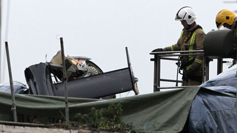 The damaged helicopter rests on the roof of the Clutha Bar.