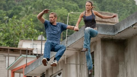 """Walker and Jordana Brewster -- who played his love interest, Mia, in the films -- in """"Fast 5."""""""