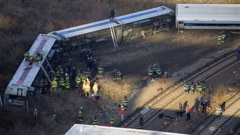 First responders gather at the scene of the derailment.