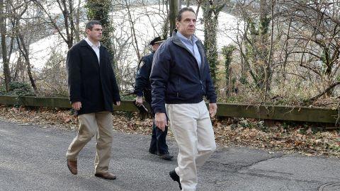 New York Gov. Andrew Cuomo, right, arrives on the scene December 1.