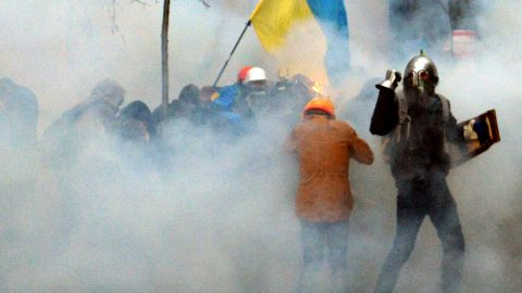 Pro-EU demonstrators clash with police near the presidential administration office on December 1.