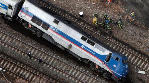 A train car lies on its side after derailing December 1.