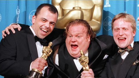 Filmmakers Tyron Montgomery(L) and Thomas Stellmach(R) pose with comedian-actor Chris Farley(C) after they won the Oscar for best animated short film for 'Quest' 24 March during the 69th Annual Academy Awards in Los Angeles, California.