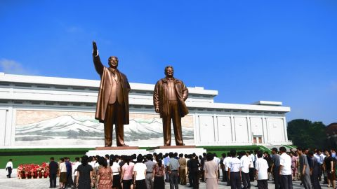 Statues of Kim Il Sung (left) and Kim Jong Un (right) at Mansudae in Pyongyang. North Koreans gather in front of the statues to lay flowers and bow, showing their respect for the late leaders. Tourists visiting North Korea are expected to do the same.