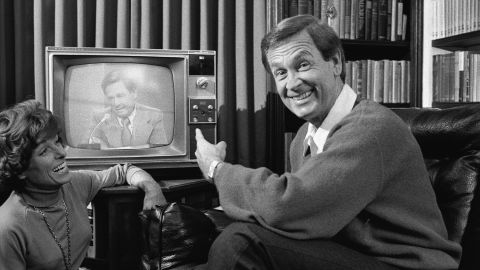 Barker points to himself on television as his wife looks on and laughs in 1977. Dorothy Jo died from lung cancer in 1981.