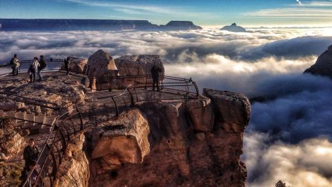 """Grand Canyon National Park in Arizona was the second most popular national park last year. Shown here is <a href=""""http://www.cnn.com/2013/12/03/travel/grand-canyon-inversion/index.html?iref=allsearch"""">an inversion:</a> cold fog trapped in the canyon by a """"lid"""" of warm air. What makes it rare are the sunny skies accentuating the layers of air."""