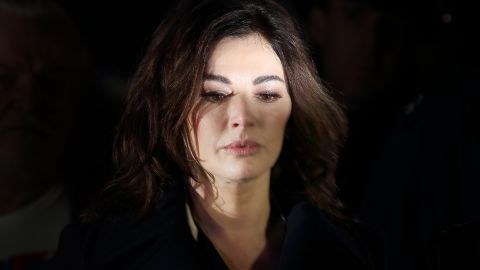 ISLEWORTH, ENGLAND - DECEMBER 04: Nigella Lawson (2L) leaves Isleworth Crown Court after giving evidence on December 4, 2013 in Isleworth, England. Italian sisters Francesca and Elisabetta Grillo, who worked as assistants to Nigella Lawson and Charles Saatchi, are accused of defrauding them of over 300,000 GBP. (Photo by Peter Macdiarmid/Getty Images)