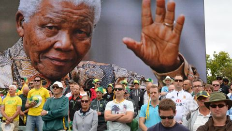 Australian and English cricket fans in Adelaide, Australia, observe a minute of silence December 6, to mark the passing of Nelson Mandela.