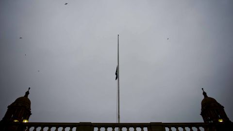 The South African flag is flown at half-staff at the Union Buildings on December 6 in Pretoria, South Africa.