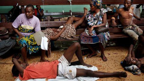 Civilians wait for treatment at Bangui's hospital after a daylong gun battle between Seleka soldiers and Christian militias on December 5.