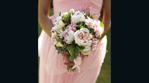 Being the maid of honor entails a lot of responsibility, from managing the wedding party to holding up the bride's bustle.