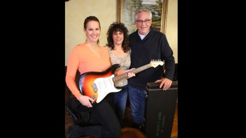 """Dawn Peterson, center, appears with """"History Dectives"""" Elyse Luray and Wes Cowan.  Peterson brought the guitar to the to PBS show """"History Detectives"""" for authentication."""