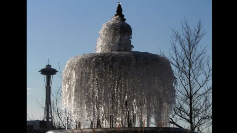 A fountain stands frozen in Chandler's Cove at South Lake Union in Seattle on Friday, December 6.