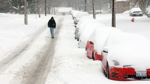 A pedestrian walks down the street after a heavy snowfall on December 6 in Carbondale, Illinois.