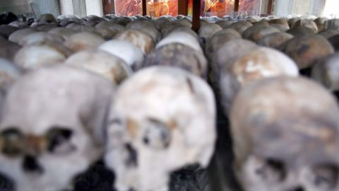 Cambodian Buddhist monks bless victims' skulls at the Choeung Ek Killing Fields memorial in Phnom Penh on April 17, 2008.