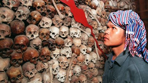 Cambodian Sam Vishna, 28 years, looks at a mixture of brown and white skulls that make up a map of Cambodia at Tuol Sleng (S-21 prison) Museum in Phnom Penh, 9 December.