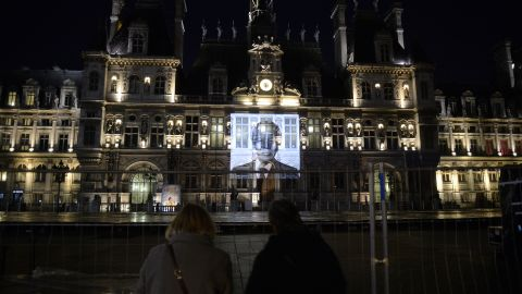 A portrait of Mandela is projected onto city hall in Paris on December 8.