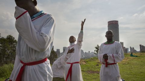 Christians mourning the loss of Mandela say prayers on a hilltop overlooking Johannesburg on December 7.
