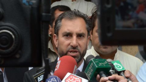 Samiullah Afridi (C), lawyer for Pakistani doctor Shakil Afridi, who assisted the CIA in their hunt for Osama bin Laden, speaks with the media after a hearing in Peshawar on October 30, 2013.