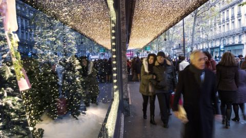 """<strong>""""A Joyful Obsession,"""" Printemps, Paris:</strong> The Prada Christmas display has 11 windows (four animated, seven high fashion), a 16-meter-long Santa sleigh track and 150 stars and snowflakes."""