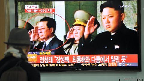 A South Korean man watches TV news about the dismissal of Jang Song Thaek, North Korean leader Kim Jong-Un's uncle